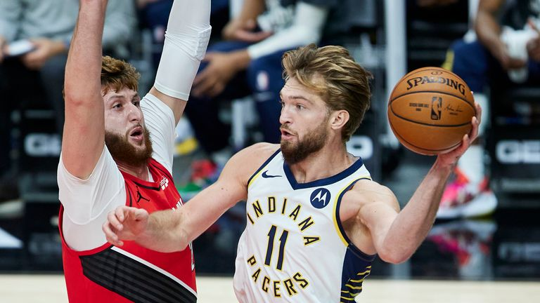 Indiana Pacers forward Domantas Sabonis, right, passes the ball away from Portland Trail Blazers center Jusuf Nurkic during the first half of an N
