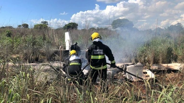 Members of the fire brigade work in the area where a plane crashed near Palmas, Tocantins state, central Brazil, on January 24, 2021