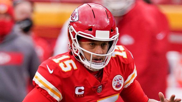 Kansas City Chiefs quarterback Patrick Mahomes scrambles during the first half. (AP Photo/Charlie Riedel)