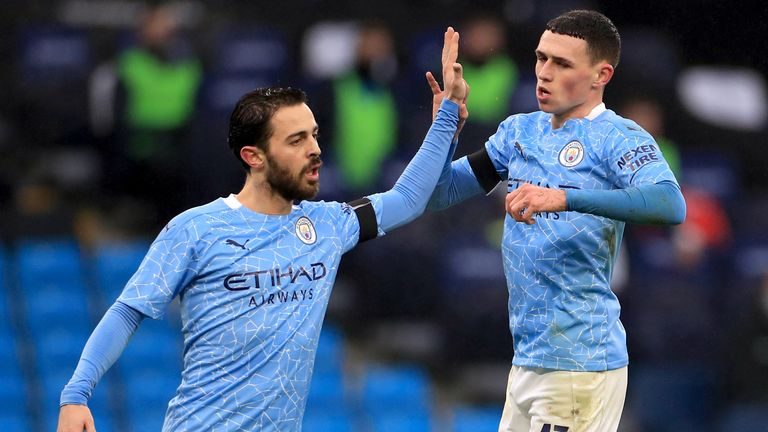 Phil Foden celebrates scoring Man City's third goal against Birmingham with team-mate Bernardo Silva