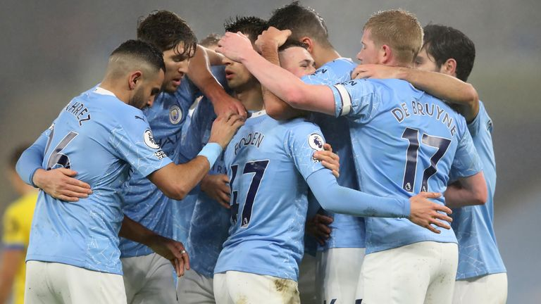 Phil Foden celebrates what proved to be the winning goal against Brighton on Wednesday night with his Manchester City team-mates