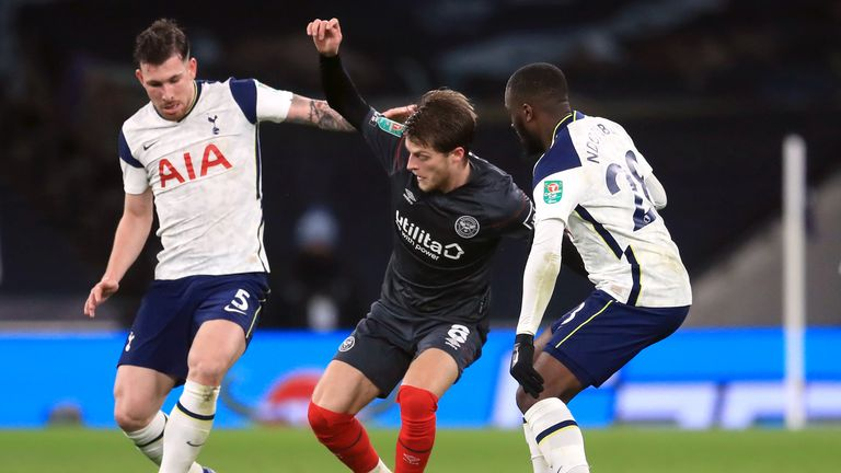 Jensen battles for the ball with Tanguy Ndombele and Pierre-Emile Hojbjerg