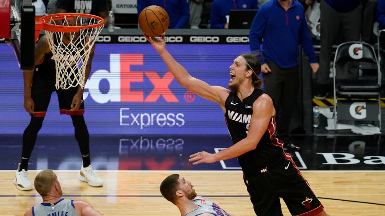 Miami Heat forward Kelly Olynyk (9) drives top the basket over Detroit Pistons guard Svi Mykhailiuk (19) during the second half of an NBA basketball game, Monday, Jan. 18, 2021, in Miami. (AP Photo/Marta Lavandier)