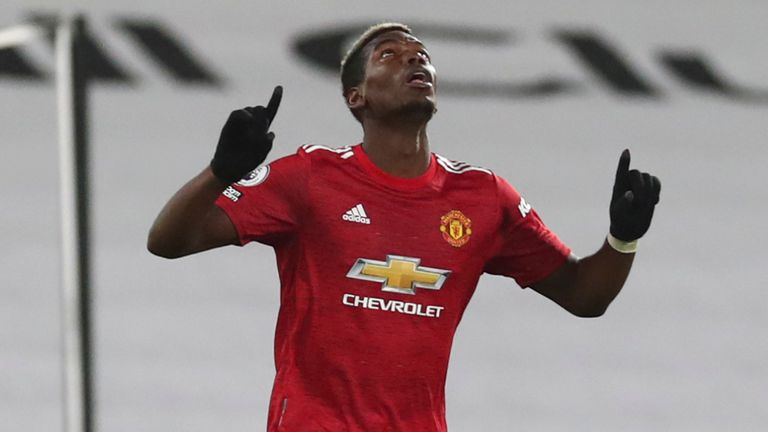 Manchester United's Paul Pogba, centre, celebrates after scoring his side's second goal during the English Premier League soccer match between Fulham and Manchester United at the Craven Cottage stadium in London, Wednesday, Jan. 20, 2021.