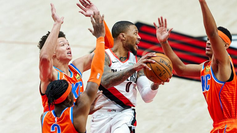 AP - Portland Trail Blazers guard Damian Lillard, center, looks to pass the ball away from Oklahoma City Thunder forward Darius Bazley, right, forward Isaiah Roby, left, and guard Shai Gilgeous-Alexander