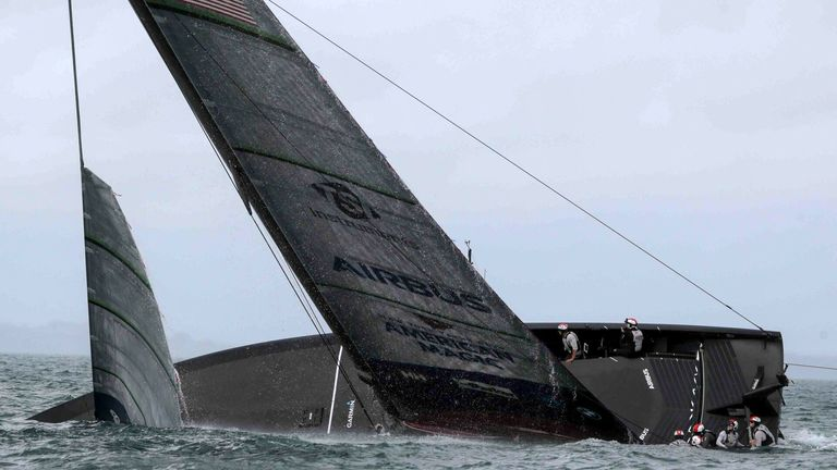 American Magic capsizes during the Prada Cup.