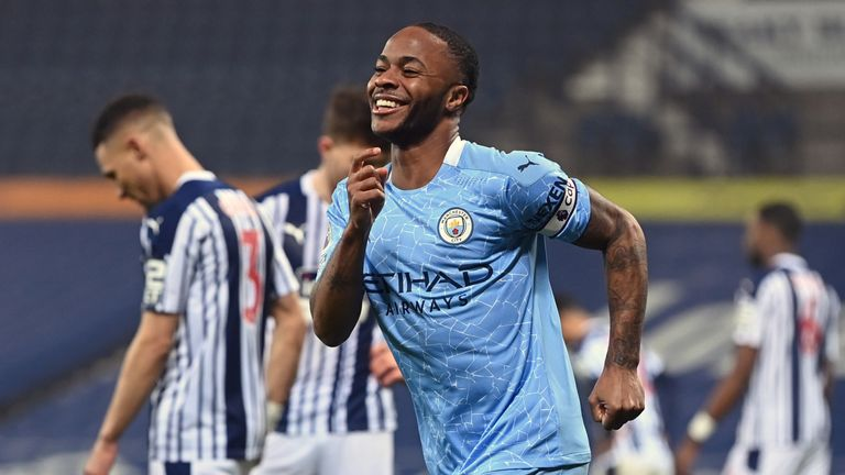 Raheem Sterling smiles after scoring Man City's fifth goal
