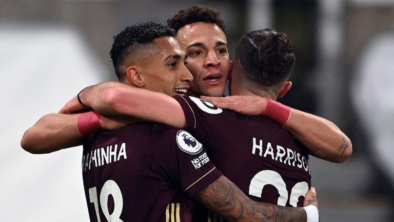 Raphinha (left) celebrates scoring Leeds' opener