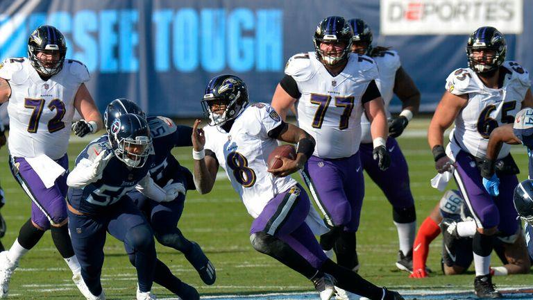 AP - Baltimore Ravens quarterback Lamar Jackson (8) runs 48 yards for a touchdown against the Tennessee Titans