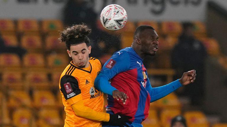 Rayan Ait Nouri battles for the ball with Christian Benteke - AP photo