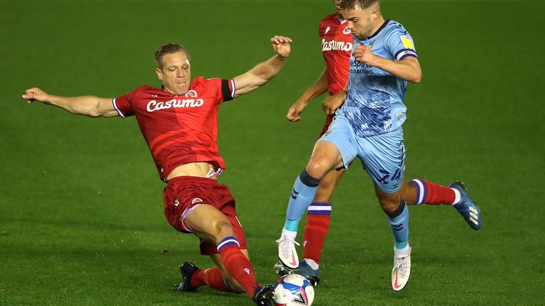 Coventry City's Matt Godden (right) and Reading's Michael Morrison battle for the ball during the Sky Bet Championship match at St Andrews, Birmingham.