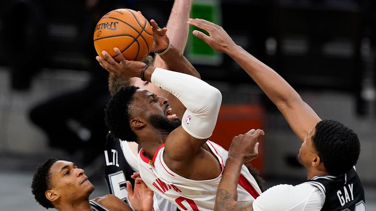 Houston Rockets forward David Nwaba is foiled by Rudy Gay as he tries to shoot against the San Antonio Spurs