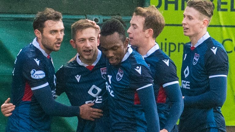 Ross County's Charlie Lakin (second from left) celebrates after he makes it 2-0 during a Scottish Premiership match between Ross County and Aberdeen at The Global Energy Stadium