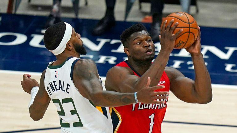 AP - Utah Jazz forward Royce O'Neale (23) guards New Orleans Pelicans forward Zion Williamson (1)