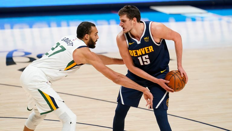 Utah Jazz center Rudy Gobert defends against Denver Nuggets center Nikola Jokic