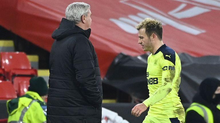 Ryan Fraser walks past Steve Bruce after being sent off against Sheffield United (AP)