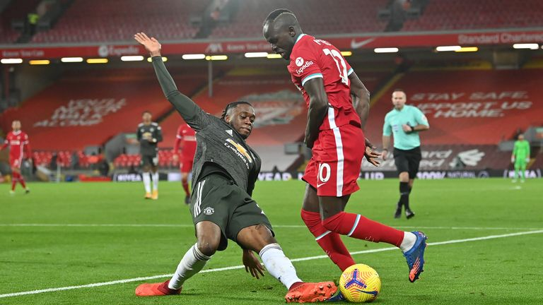 Aaron Wan-Bissaka and Sadio Mane vie for the ball during the goalless draw between Liverpool and Manchester United at Anfield