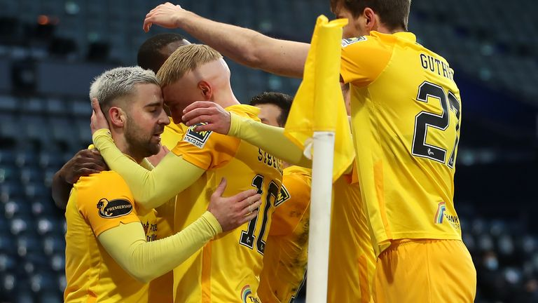 Livingston's Scott Robinson (left) celebrates with his team-mates after scoring the only goal