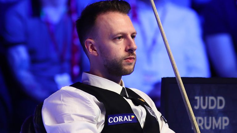 Judd Trump opened his German Masters campaign with a comfortable win
