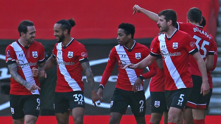 Southampton players celebrate their first goal of the goal scored by Arsenal's Gabriel