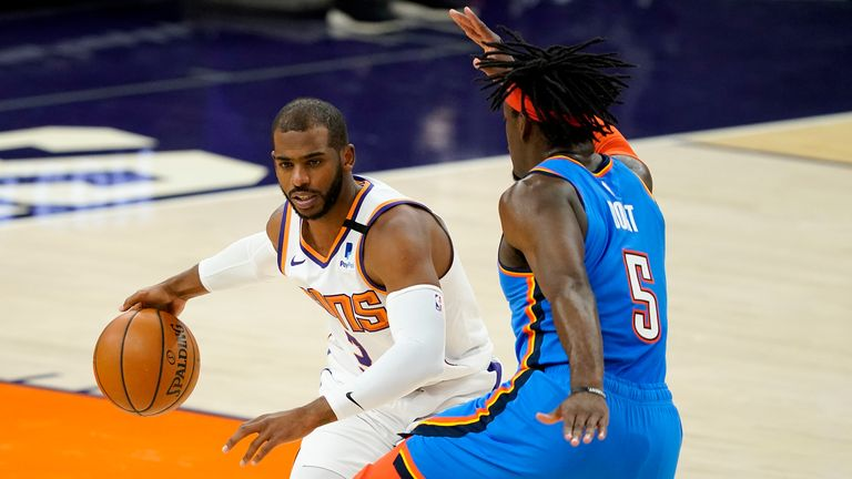 Phoenix Suns guard Chris Paul drives past Oklahoma City Thunder forward Luguentz Dort