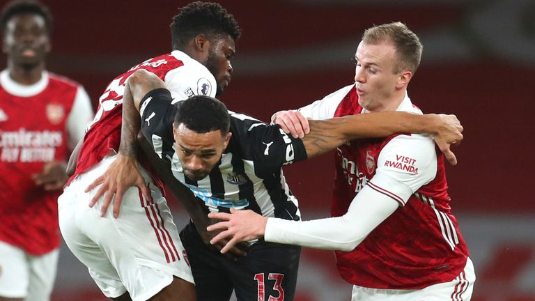 Thomas Partey, left, Arsenal's Rob Holding, right, and Newcastle's Callum Wilson