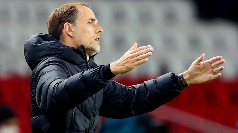 PSG's head coach Thomas Tuchel gestures as he stands on the touchline during the French League One soccer match between Paris Saint-Germain and Angers at the Parc des Princes in Paris, France, Friday, Oct. 2, 2020. (AP Photo/Francois Mori)