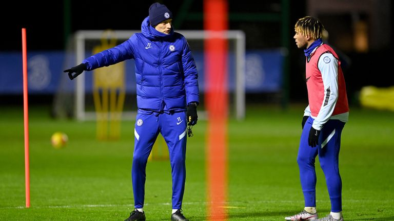Thomas Tuchel speaks with Reece James during a training session at Cobham