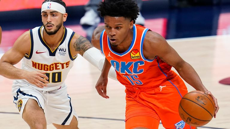 Oklahoma City Thunder forward Josh Hall, right, drives past Denver Nuggets guard Markus Howard during the second half of an NBA basketball game Tuesday, Jan. 19, 2021, in Denver. The Nuggets won 119-101.