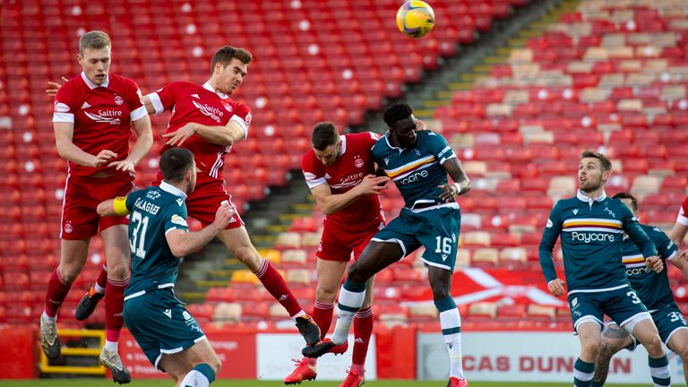 Aberdeen's Tommie Hoban (centre) makes it 1-0 with a header at Pittodrie