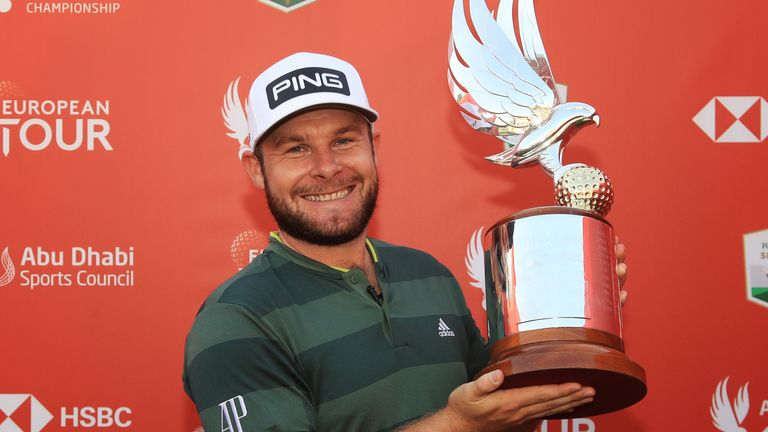 Tyrrell Hatton with his prize after a four-shot win
