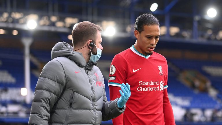 Liverpool's Virgil van Dijk leaves the game with an injury after a challenge by Everton goalkeeper Jordan Pickford during the Premier League match at Goodison Park, Liverpool.