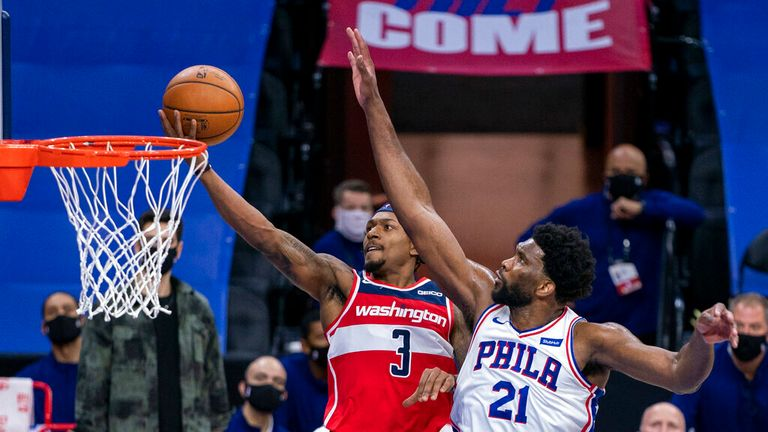 AP- Washington Wizards guard Bradley Beal, left, goes up for the shot against Philadelphia 76ers center Joel Embiid