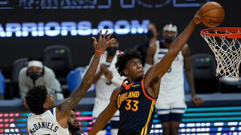 Golden State Warriors center James Wiseman dunks against Minnesota Timberwolves forward Jaden McDaniels