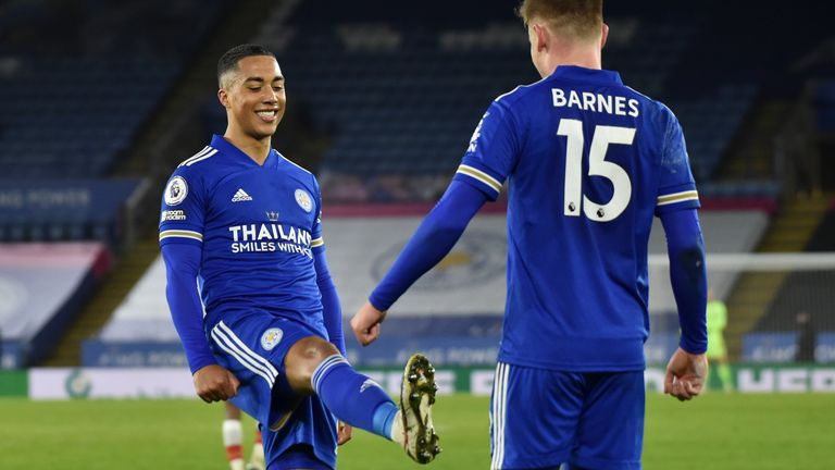 Youri Tielemans celebrates Barnes' late strike after his second assist