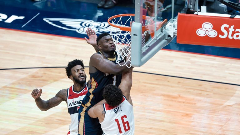 New Orleans Pelicans forward Zion Williamson shoots over Washington Wizards forward Anthony Gill and forward Jordan Bell