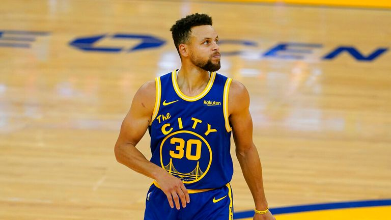 AP - Golden State Warriors guard Stephen Curry reacts during the second half of the team's NBA basketball game against the New York Knicks
