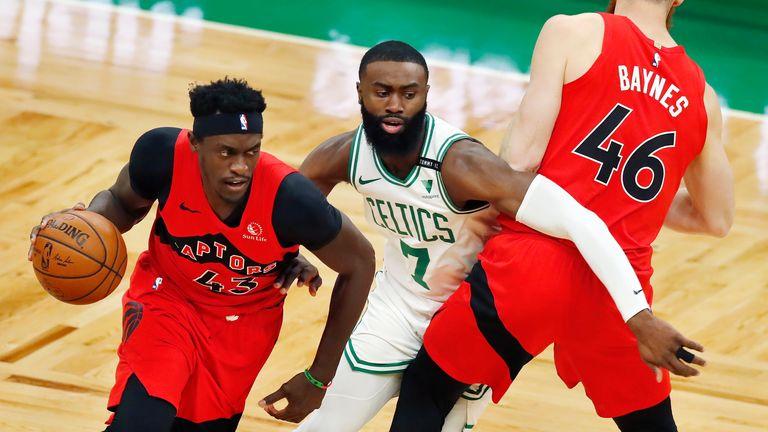 Boston Celtics' Jaylen Brown defends against Toronto Raptors' Pascal Siakam as Aron Baynes provides a screen