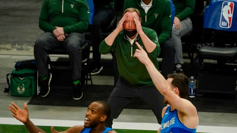 AP - Milwaukee Bucks head coach Mike Budenholzer reacts to a call during the second half