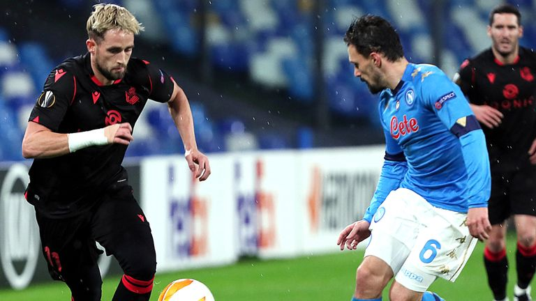 NAPLES, ITALY - DECEMBER 10: Adnan Januzaj of Real Sociedad competes for the ball with Mario Rui of SSC Napoli ,during the UEFA Europa League Group F stage match between SSC Napoli and Real Sociedad at Stadio Diego Armando Maradona on December 10, 2020 in Naples, Italy. (Photo by MB Media/Getty Images)