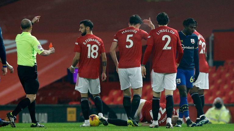 Referee Mike Dean shows a red card to Southampton's Alex Jankewitz (AP)