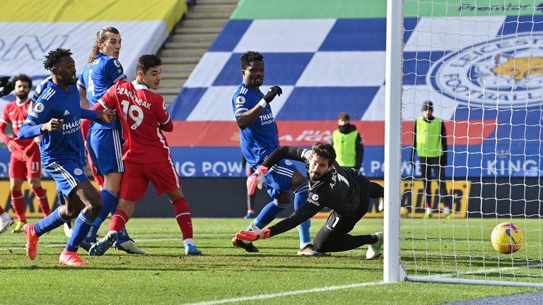 Alisson fails to save James Maddison's free kick (AP)