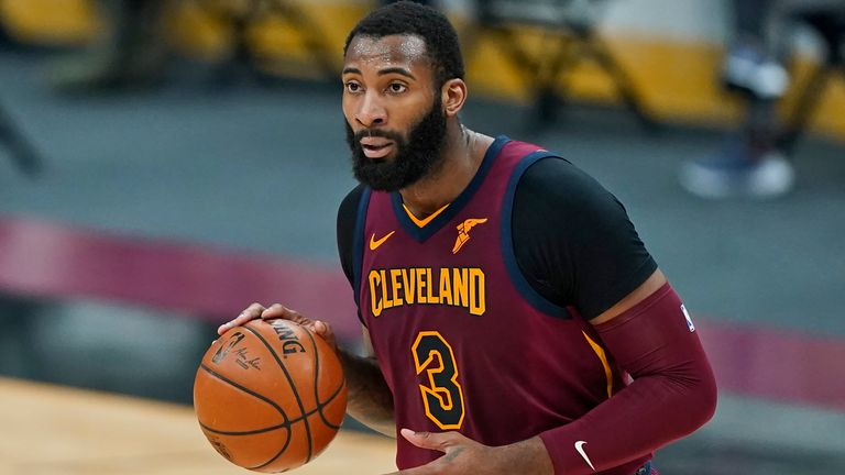 Cleveland Cavaliers' Andre Drummond drives the second half of an NBA basketball game against the Milwaukee Bucks, Friday, Feb. 5, 2021, in Cleveland. (AP Photo/Tony Dejak)