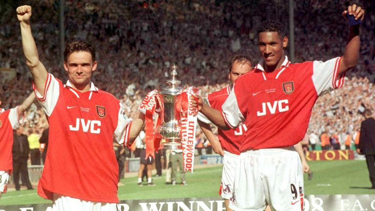 Nicolas Anelka holds the FA Cup with Marc Overmars in May 1998