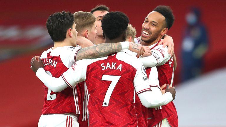 Arsenal players celebrate with Pierre-Emerick Aubameyang