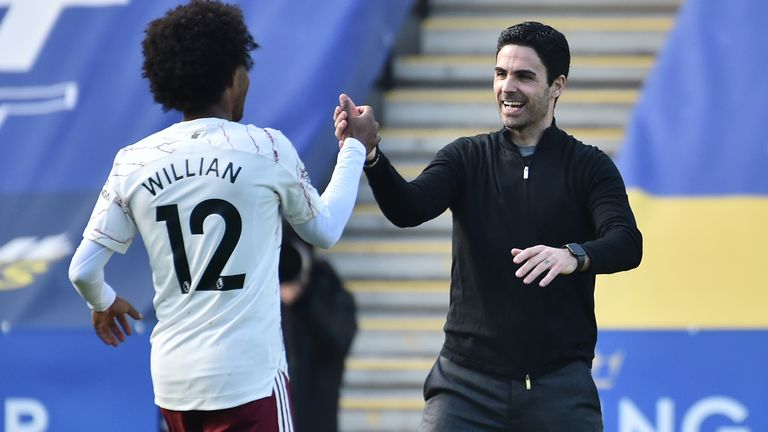 Willian and Arsenal manager Mikel Arteta celebrate at full-time at Leicester