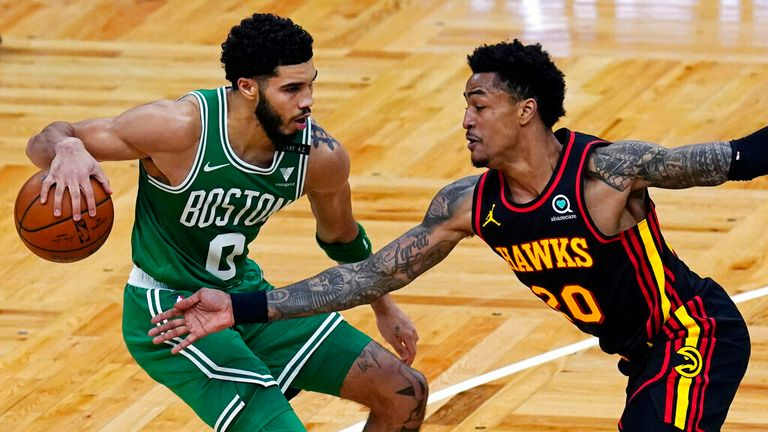 AP - Atlanta Hawks forward John Collins (20) tries to steal the ball against Boston Celtics forward Jayson Tatum (0)