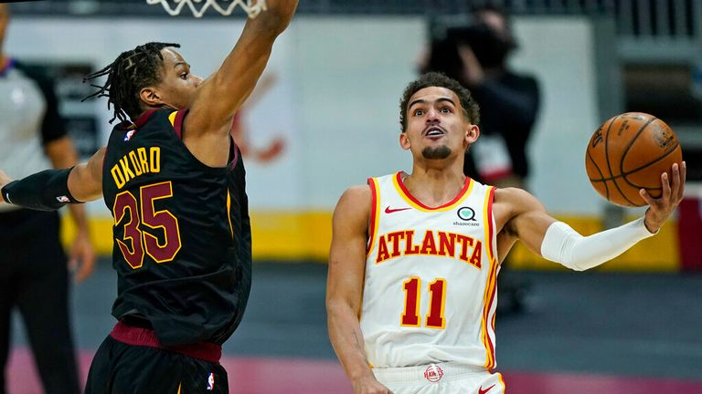 AP - Atlanta Hawks' Trae Young (11) drives to the basket against Cleveland Cavaliers' Isaac Okoro (35)