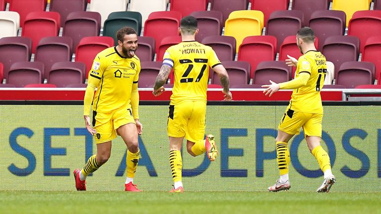 Barnsley's Carlton Morris (left) celebrates scoring their side's second goal of the game with…