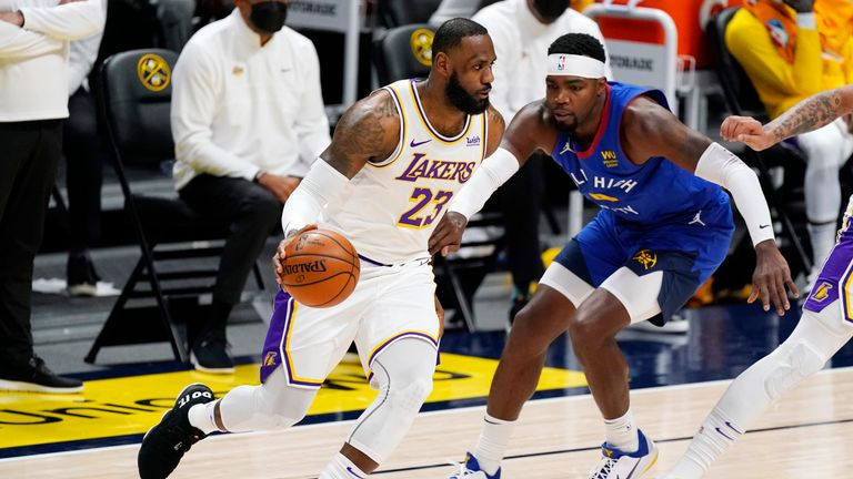 Los Angeles Lakers star LeBron James ran the length of the court before finishing with the one-handed dunk against the Denver Nuggets.